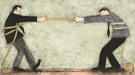 Two businessmen having a tug of war